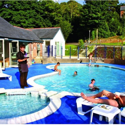 Outdoor pool and waiter service
