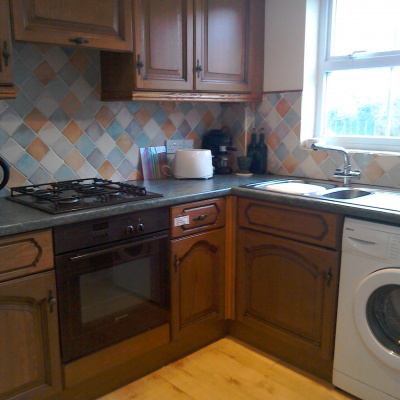 Kitchen with full size fridge, freezer,oven,hob,washing machine etc