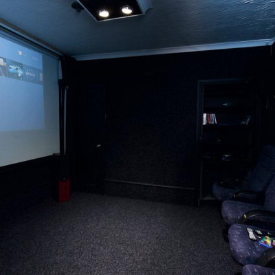 Private cinema room with authentic cinema seats and PS4 hook up