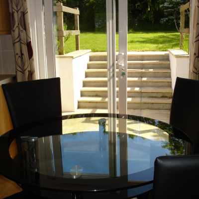 Dining area with terrace doors to back garden.