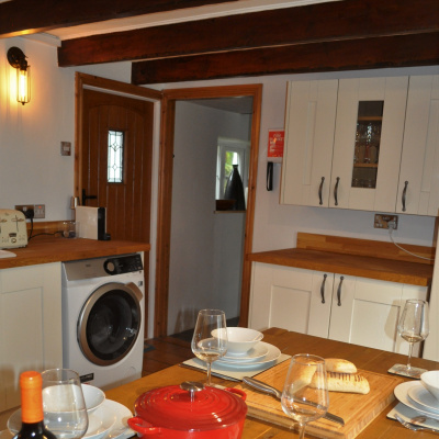 Large kitchen with modern appliances including AEG washer/dryer