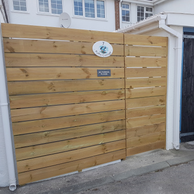 Rear Fence and gate with parking areas
