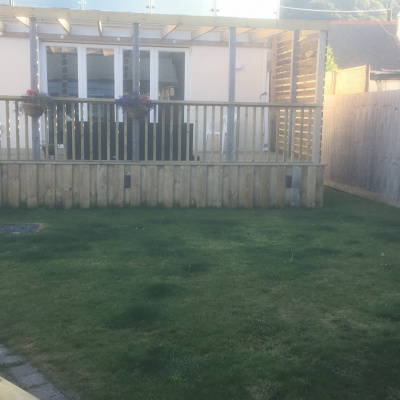 Rear decking and lawn.
