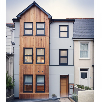 Cedar-clad front of the house
