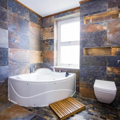 1st floor wet floor bathroom with bath and rainforest shower