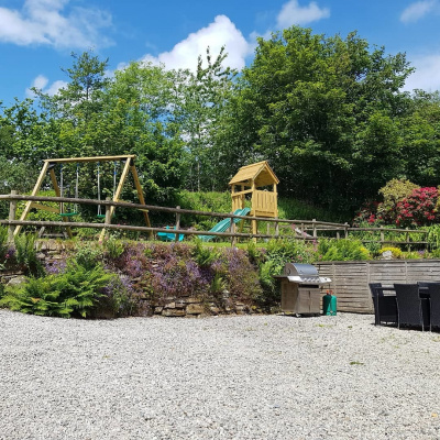Outside seating/dining area with shared garden/play area