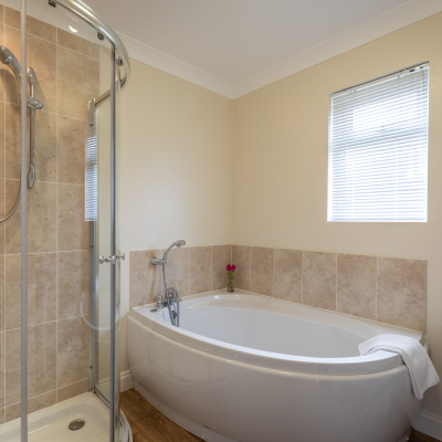 Family Bathroom with corner bath and separate shower cubicle