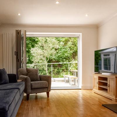 Bi-fold doors open onto the garden space
